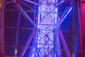 The glass capsule gives you fantastic views of the ferris wheel