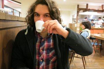 Me drinking an espresso.