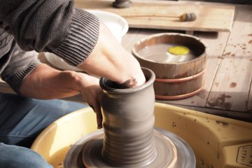 An artisan creates a pot with the ease of a master