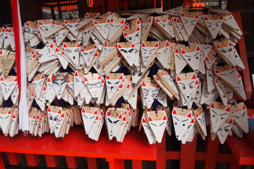 Fushimi Inari Shrine fox face plaques. Write your wish, draw a face on the plaque, and say your prayer