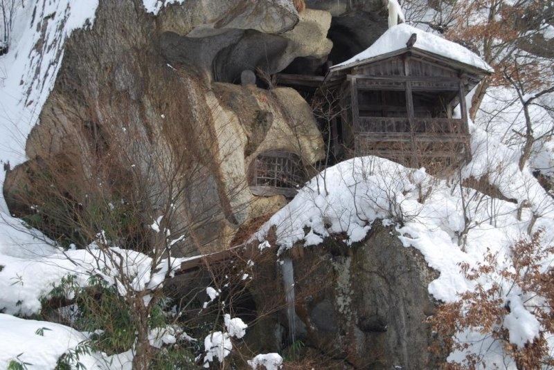 Caves carved into the volcanic rock of the mountain were used for prayer and ascetic practice in the old days