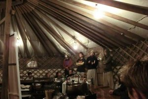 Nightly meeting in the yurt cafe/bar