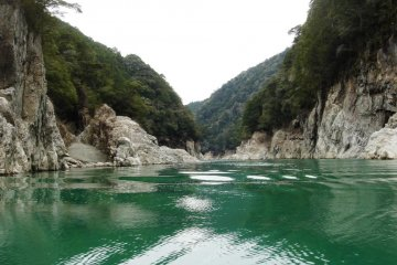 Emerald-green waters and steep cliffs on both sides of the gorge