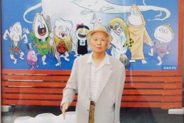 Picture of Shigeru Mizuki at the local Fish Market