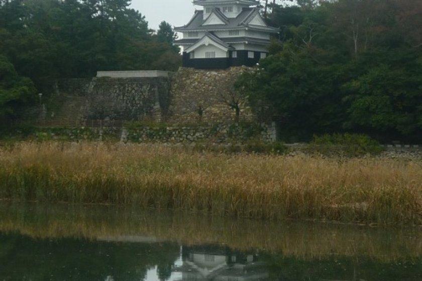 Yoshida Castle reflected in the Toyokawa river, a natural moat