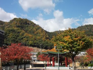 The approach to Shin-Kobe station, with Mount Maya behind