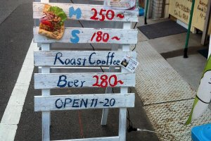 The signboard outside Bar Stand KuKai
