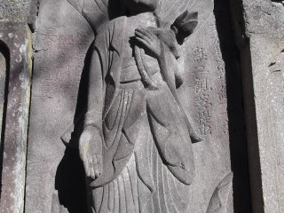 One of the carved figures on the big grave