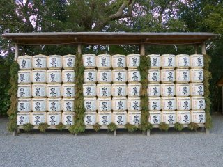 Decorative sake barrels, or kazaridaru, are stacked throughout the complex