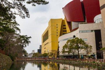 The Riverwalk Kitakyushu shopping mall sits along the castle moat