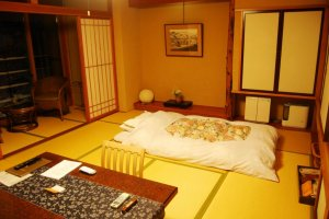 A traditional Japanese-style room with futon
