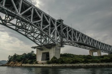 Going underneath the bridge by boat