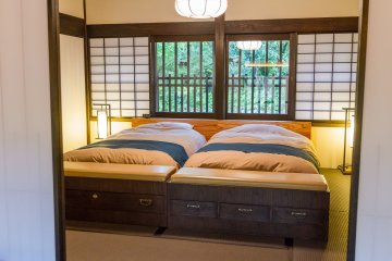 The fine woodwork and fabric of the beds