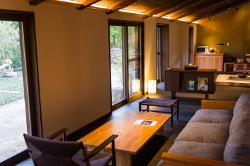 The sofa and lounge area faces the large garden windows