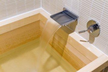 Relax in a koyamaki, or pine, bathtub