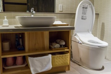 The clean and modern bathroom has full amenities