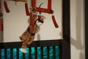 A marionette doll in action at the Karakuri Museum.