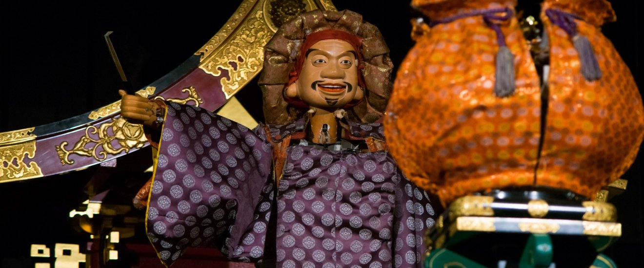 A marionette in action at the Karakuri Museum.