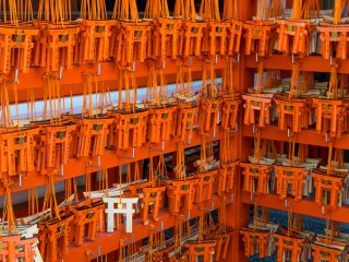 Visitors to Fushimi Inari-taisha offer their prayers on miniature torii gates.