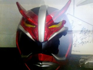 Red Autographed Kamen Rider or Gundam Like Manga Cosplay Masks the size of Motorbike helmets at the Akita Design Hub and Handicraft Center