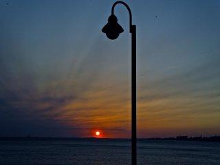 Beachfront lamppost silhouette