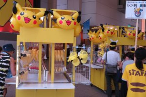 Many vendors selling Pikachu items at Queens Square