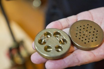 Handmade pasta is pressed through these brass pieces