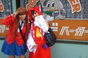 Cute Cosplay Couple in front of (old style) God Burger