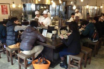 Counter surrounding the kitchen at Josui, Nagoya's popular ramen restaurant