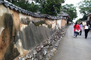 The warped walls lining the streets in Kitsuki