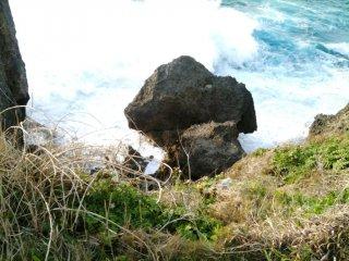 Waves Crash into the Cliffs at Cape Manza
