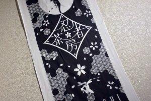 Ninja Kunoichi Cafe's logo tenugui towel makes a good souvenir
