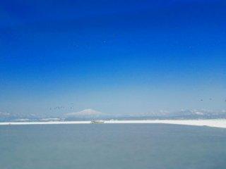 Mt.Chokai seen from Lake Nonomura in Mamurogawa Town in winter. Mt. Chokai is a 2,236 meters high mountain