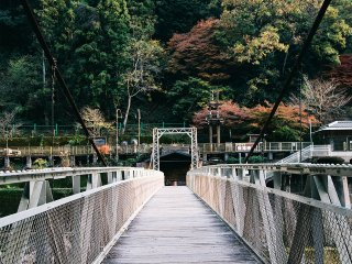 A narrow bridge leading to Hozukyo torokko station, Saga Scenic Railway