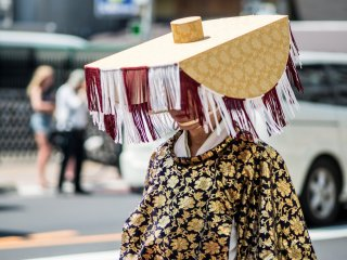 This local walks the street in traditional costume as part of a parade