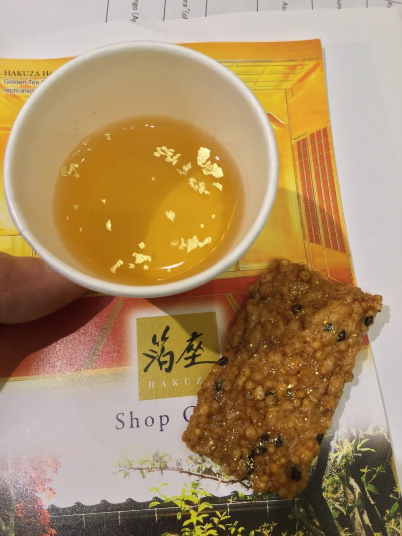 Gold flakes on tea and embedded in rice crackers.