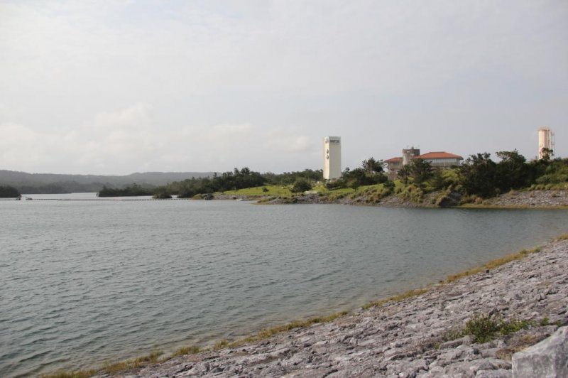 <p>Kurashiki Dam, as seen from the road across it, is the largest in Okinawa by surface area</p>
