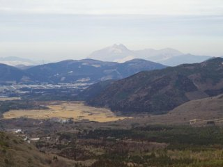 Looking back toward Chojabaru and Mt. Yufu's distinctive twin peaks 20km away