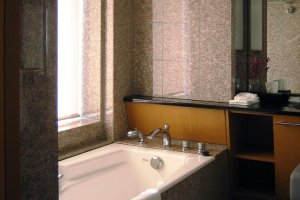 Panoramic sky views from the bath of the guest room at Cerulean Hotel Tokyu Shibuya