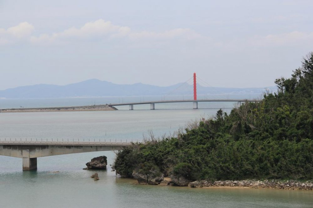 The Yakena Staits narrow passage only accomodates small recreational vessels; the bridge that connects Okinawa to neighboring Henza, Hamahiga, Miyagi and Ikei Islands is seen in the distance