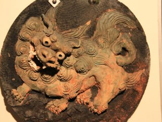 Shisa dogs can be placed on walls like this one found in the Gyokusendo Cave
