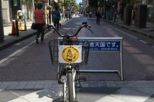 A Kashiwa City rental bike with the Reysol mascot on the basket