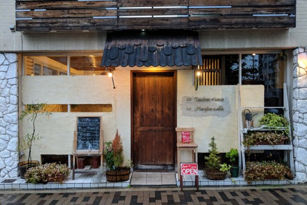 The exterior of Morpho Cafe - warm, charming and inviting.