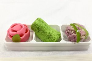 Seasonal rose and hydrangea wagashi, with a mossy stone in the middle!