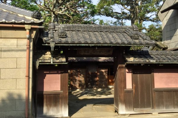 The gate and red walls of the old house