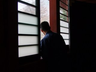 A temple monk, looking out to the lake
