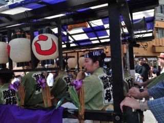 The musicians being transported through the procession