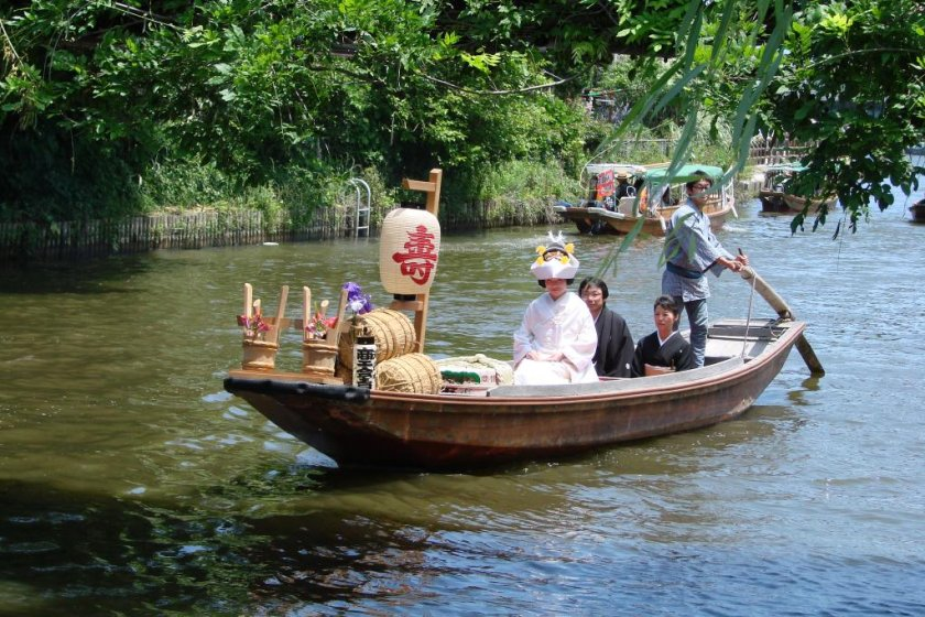A bride on the waterways of Itako