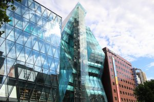 WeWork Iceberg: an asymmetric glass façade with external elevator shaft