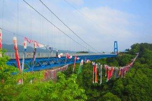 Brilliantly blue Ryujin Bridge with carp streamers